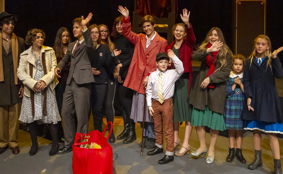 A Christmas Carol Cast Waving